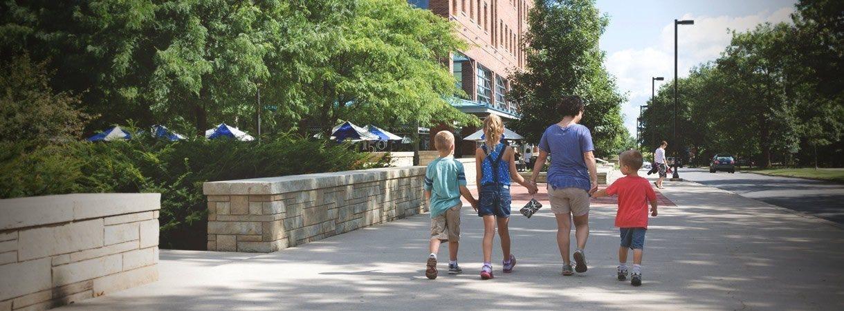 Family walking toward Berkey Creamery
